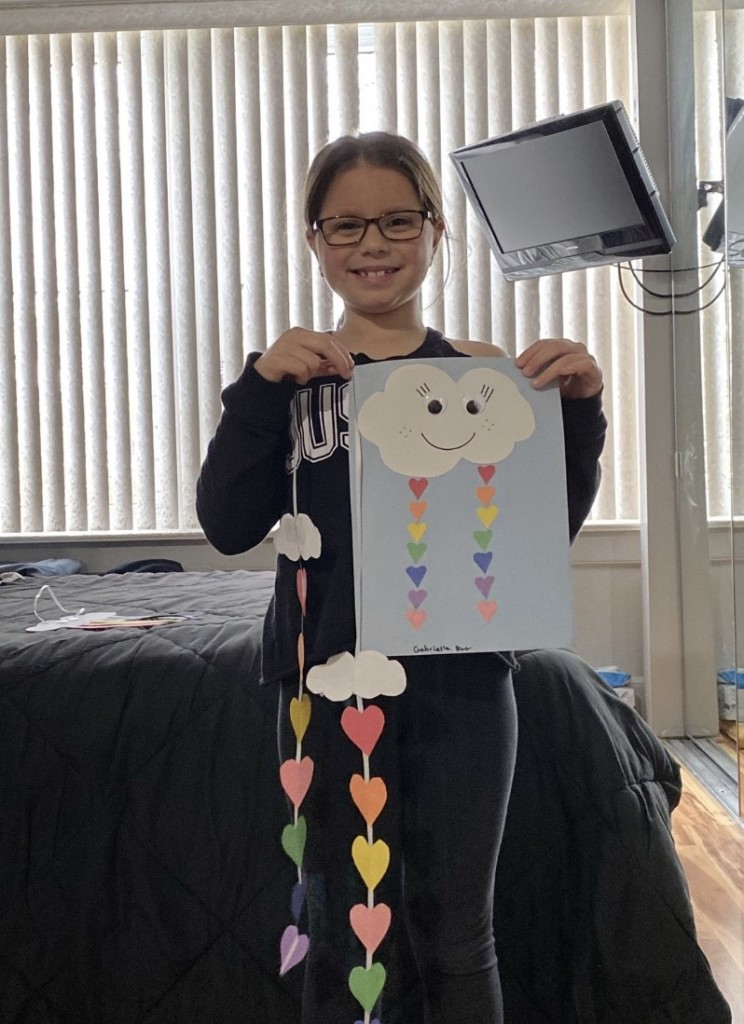 Girl Student Holding a rainbow