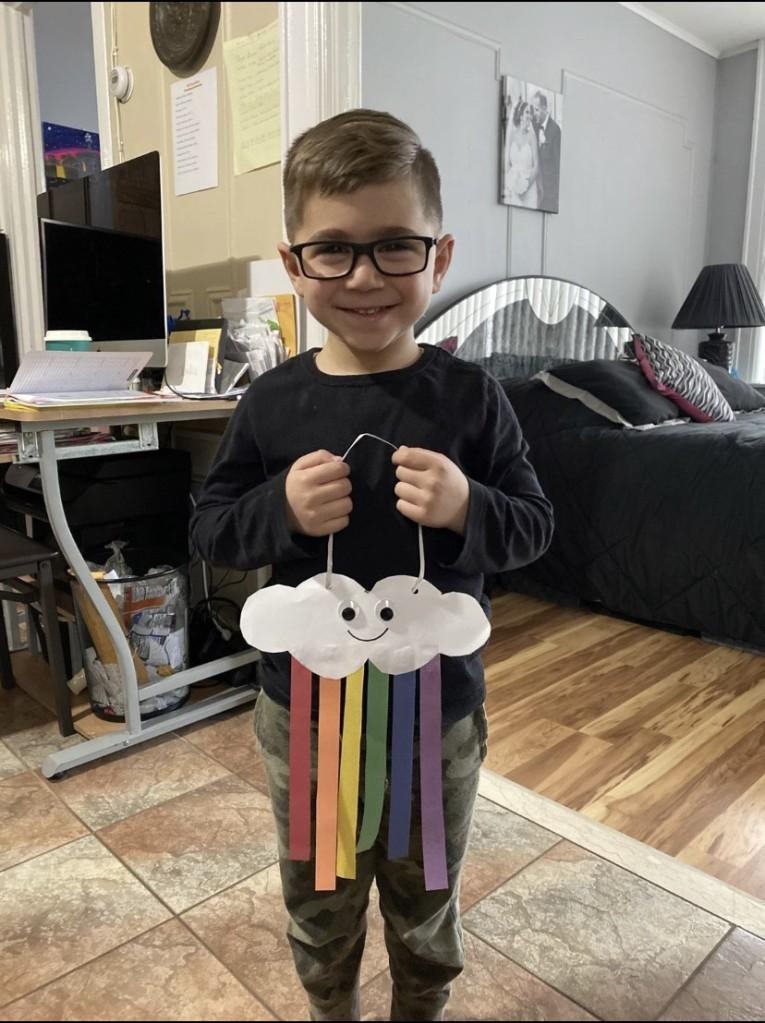 Student Holding a rainbow